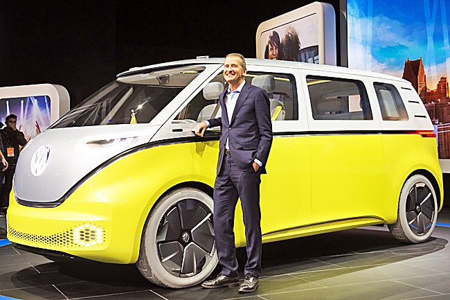 Herbert Diess , Volkswagen Brand Chief, during the unveiling of Volkswagen ID Buzz autonomous minibus concept during the 2017 North American International Auto Show in Detroit, Michigan. - AFP