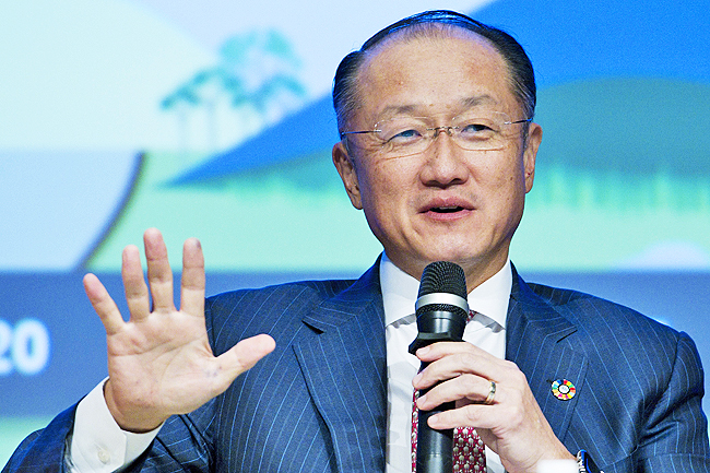 World Bank President Jim Yong Kim speaks during a panel discussion at the World Bank/IMF Annual Meetings at IMF headquarters in Washington. - AP