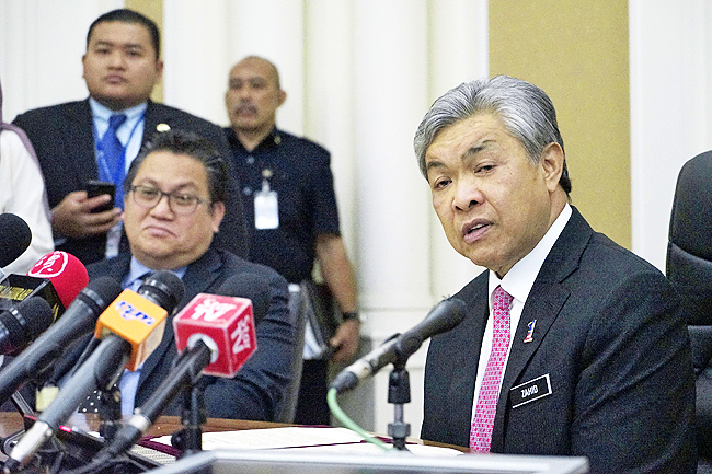 Malaysian Deputy Home Minister Zahid Hamidi (R)speaks to media during a press conference in Putrajaya, Malaysia, February 16. Two women holding foreign passports have been arrested in the killing of the North Korean leader's estranged half brother who was reportedly poisoned by a pair of female assassins who assaulted him as he waited for a flight this week in Malaysia, police said Thursday. - AP