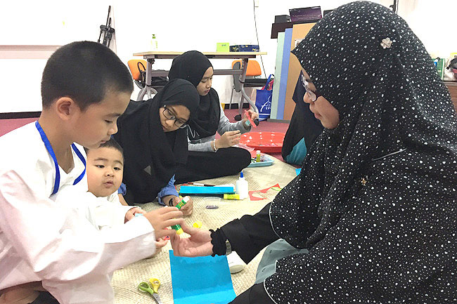 Young participants of the Tarbiyah Project for Kids engaged in an activity. - SYAZWANI HJ ROSLI