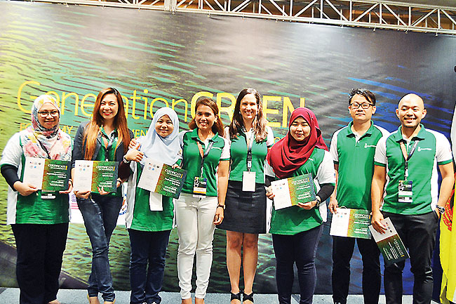 Bruneian delegates with Catherine Muller and Cherrie Atilano. - PHOTOS: FIZAH HAB
