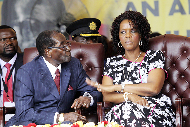 Zimbabwean President Robert Mugabe and his wife Grace are seen during his birthday celebrations in Masvingo in this file photo. - AP