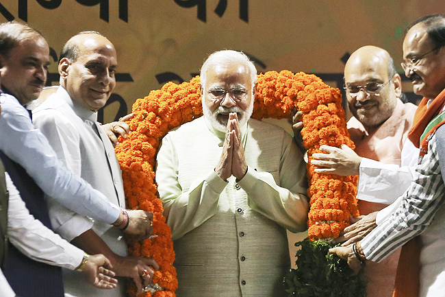 In this March 12 file photo, Indian Prime Minister Narendra Modi is garlanded during a reception at the Bharatiya Janata Party headquarters a day after the party's landslide victories in key state legislature elections in New Delhi, India. - AP