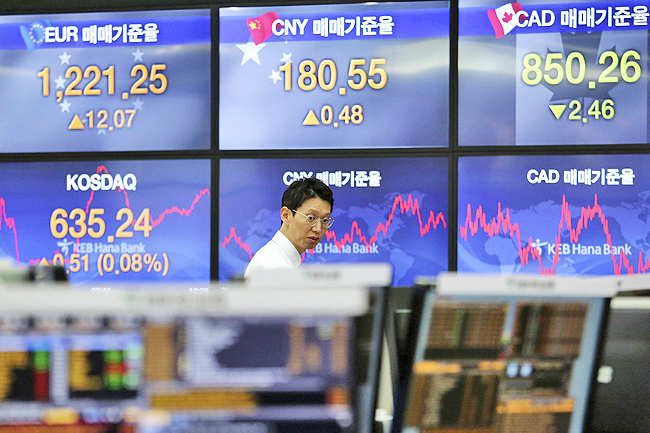 A currency trader works at the foreign exchange dealing room of the KEB Hana Bank headquarters in Seoul, South Korea. - AP