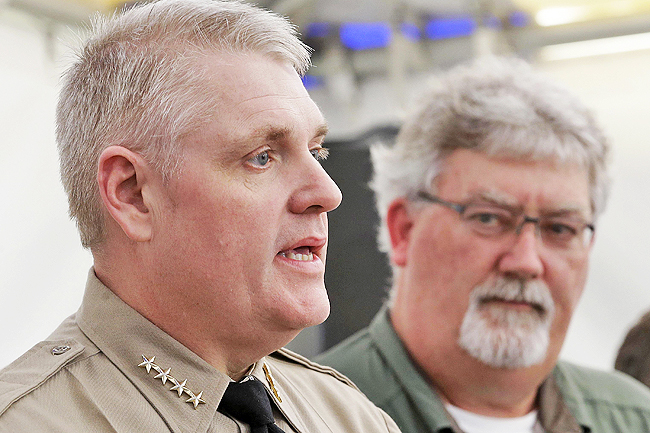 Butte County Sheriff Kory Honea (L) answers a question concerning his decision to lift the evacuation order and allow people to return home, as Bill Croyle, acting director of the Department of Water Resources, looks on during a news conference in Oroville