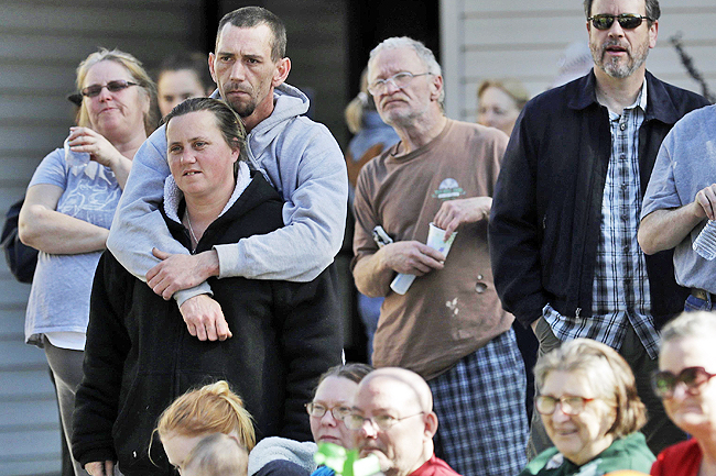 Evacuees in Chico listen to an announcement lifting the evacuation of the Oroville Dam communities