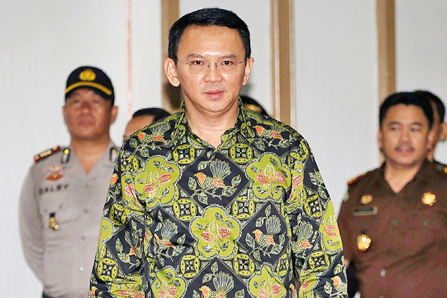 Jakarta's Governor Basuki Tjahaja Purname, also known as Ahok, arrives for his court hearing in Jakarta yesterday. - AFP