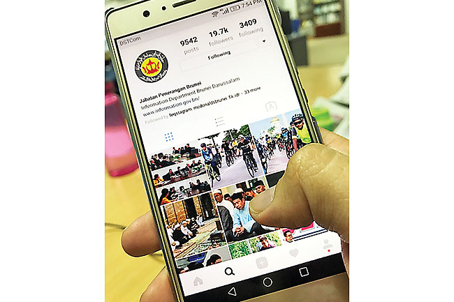 Photo shows a smartphone user scrolling the Information Department's Instagram account @infodept.bn which is named the most active government social media in a new study. – HAKIM HAYAT
