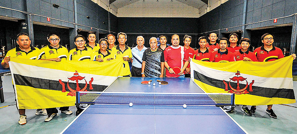 Brunei's table tennis teams in a group photo. - KHAIRIL HASSAN