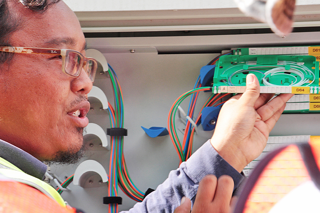 A TelBru staff explains the technicalities behind fibre optic installation currently taking place in major parts of the country. - TELBRU