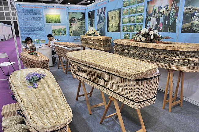 Wicker and seagrass coffins are displayed during the Asia Funeral and Cemetery Expo and Conference in Hong Kong yesterday. The expo underscores how for some investors, Asia's rapidly ageing population makes its death industry a potentially lucrative market. - AP
