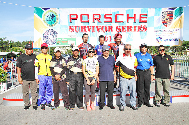 The winners pose on the podium with officials. - FADHIL YUNUS