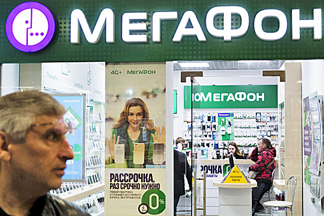 People inside a Megafon mobile phones shop in Moscow, Russia. - PHOTOS: AP