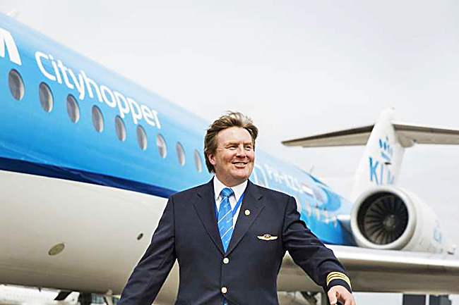 Dutch King Willem-Alexander posing in front of a KLM Cityhopper aircraft at Schiphol Airport, near Amsterdam on May 16. - AFP