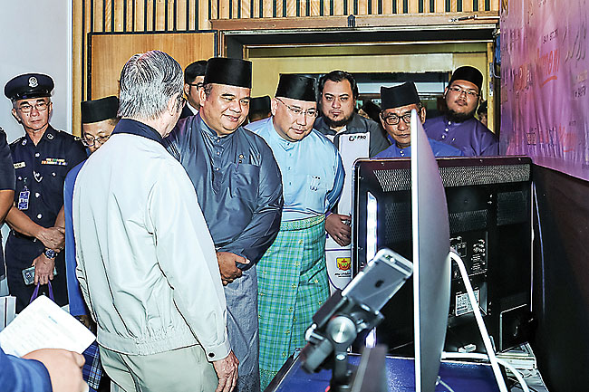 The Deputy Minister at the Prime Minister's Office tours the 'Six Decades of Radio Brunei' exhibition at Studio A of Radio Television Brunei. - PHOTOS: BAHYIAH BAKIR