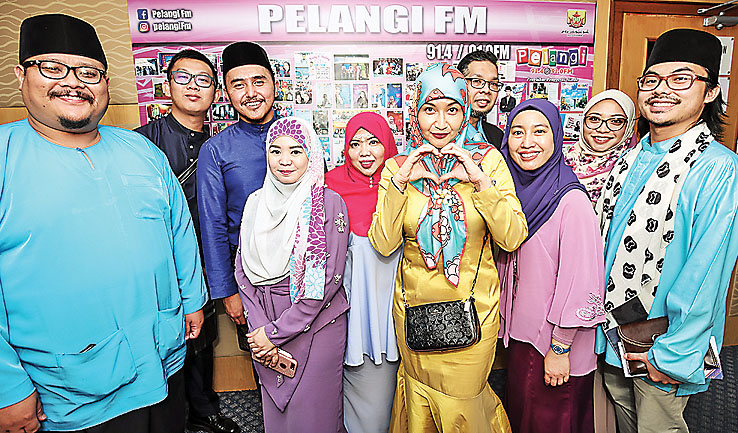 Pelangi FM deejays in a group photo