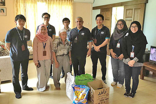 Photos above and below show representatives of Hengyi Industries donating basic necessities to less fortunate families in the Brunei-Muara District. - PHOTOS: HENGYI