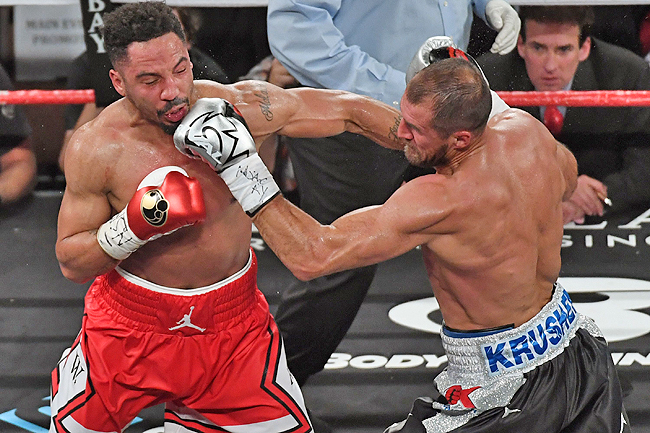 Andre Ward (left) and Sergey Kovalev battle in the third round of their light heavyweight championship bout at the Mandalay Bay Events Center. - AFP