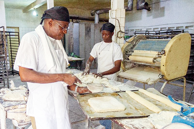Togo's 'king of bread', Bonaventure Boma, at work in in one of his bakeries in Lome. - AFP