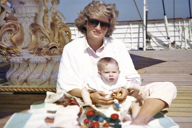 An undated file picture made available by the Kensington Palace from the personal album of the late Diana, Princess of Wales, shows a photo taken by Prince William of the late Princess Diana sitting and playing with Prince Harry aboard the Royal Yacht Britannia
