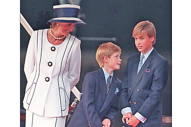 File photo dated August 19, 1995 shows Britain's Diana, Princess of Wales, and her sons Prince Harry, (centre) and Prince William, as they gather for the commemorations of VJ Day in London
