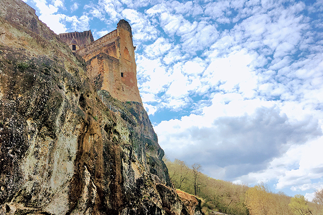 The 12th century Chateau de Commarque was built on a sheer cliff as a natural fortification