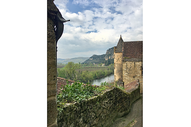 A steep switchback road leads through the medieval village of La Roque Gageac, above the Dordogne
