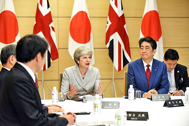 PM May seeks to ease Japan's Brexit fears during trade visit