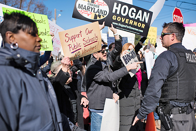 Protesters and supporters greet Governor Larry Hogan when he visited a Bethesda, Md, elementary school in March with Secretary of Education Betsy DeVos