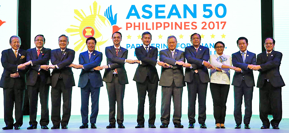 The opening ceremony of the 50thAsean Foreign Ministers' Meeting (AMM) was held at the Plenary Hall, Philippine International Convention (PICC), Pasay City, the Philippines, yesterday. The ceremony was attended by Foreign Ministers of Asean member states and spouses, Secretary-General of Asean, Asean senior officials as well as delegates. Pehin Orang Kaya Pekerma Dewa Dato Seri Setia Lim Jock Seng, Minister at the Prime Minister's Office and Minister of Foreign Affairs and Trade II, was present as the head of the delegation from Brunei Darussalam. Photo shows Pehin Dato Orang Kaya Pekerma Dewa Seri Setia Lim Jock Seng in a group photo with other Asean leaders. - DEPARTMENT OF FOREIGN AFFAIRS OF THE PHILIPPINES