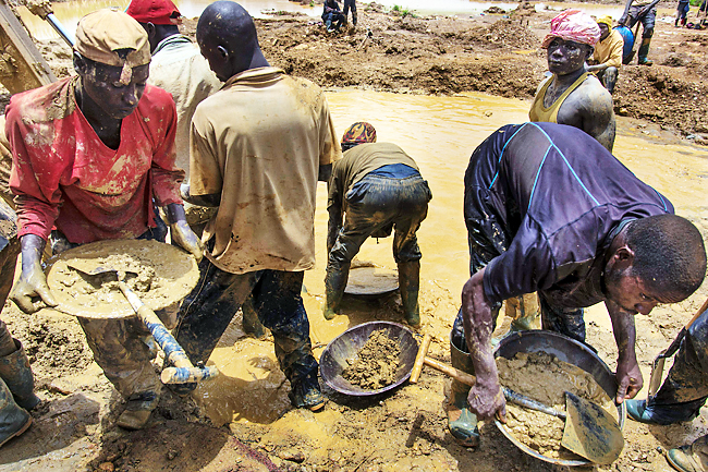 Illegal miners from Niger, working beside a pond close to Kibi town. Those dabbling in galamsey are often driven by poverty. - PHOTOS: AFP