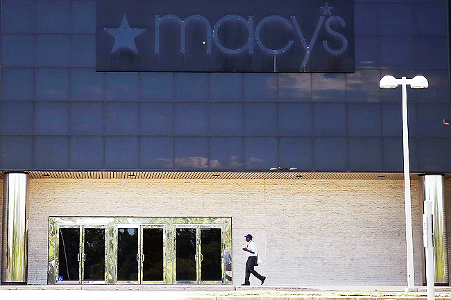 A man walks past the empty Macy's store at the closed Landmark Mall in Alexandria, Virginia. - PHOTOS: AFP