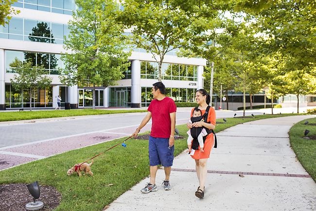 Keisuke and Idalia Yabe walk their dog through the quiet office park in North Bethesda where they purchased a home