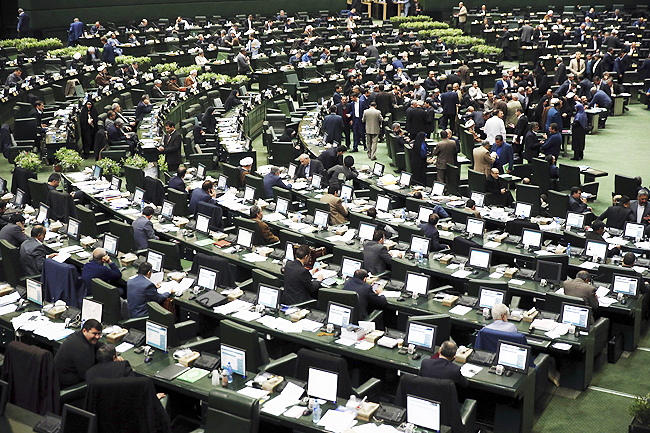 An open session of the Iranian parliament in Tehran, Iran. Iran's parliament voted overwhelmingly yesterday to increase spending on its ballistic missile programme and the foreign operations of its paramilitary Revolutionary Guard, chanting 'Death to America' in a direct challenge to Washington's newest sanctions on the Islamic Republic. - AP