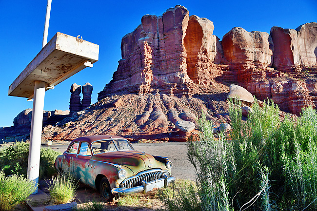 A former gas station turned into an art gallery features a vintage Buick with a backdrop of Twin Rocks, part of Bears Ears National Monument in Utah. - PHOTOS: WP-BLOOM
