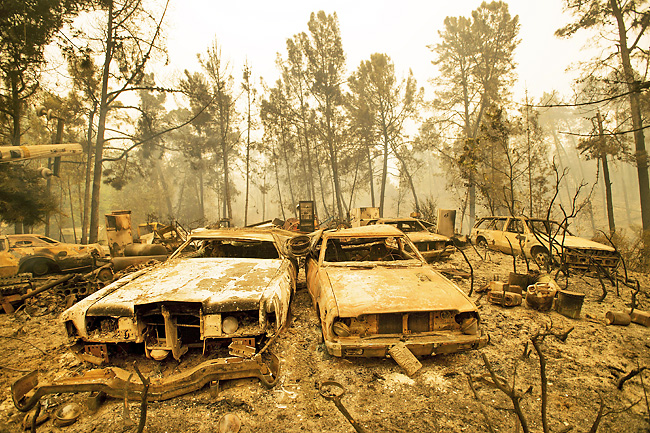 In this file photo, vintage cars line a property after a fire burned through Loma Chiquita Road near Morgan Hill, California. Since US President Donald Trump's decision in June to quit the Paris agreement on reducing greenhouse gas emissions, Beijing has proclaimed its willingness to stick to the pact. - AP