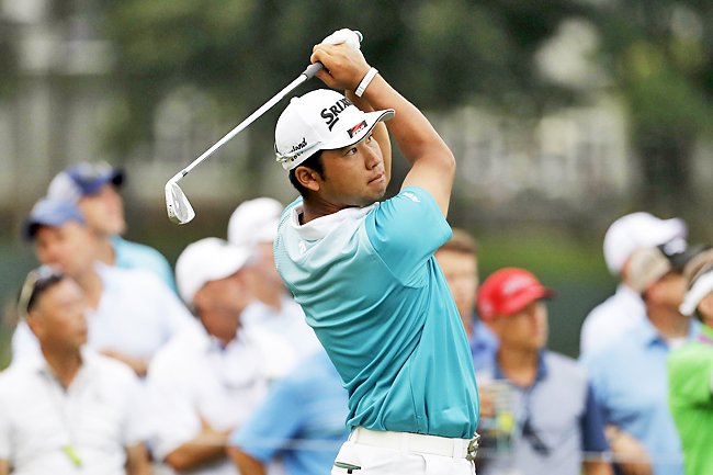 Hideki Matsuyama of Japan, watches his tee shot on the 17th hole during the second round of the PGA Championship golf tournament at the Quail Hollow Club in Charlotte, North Carolina