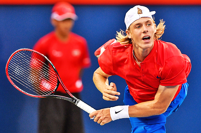 Denis Shapovalov of Canada serves against Adrian Mannarino of France during day eight of the Rogers Cup presented by National Bank at Uniprix Stadium in Montreal. - AFP