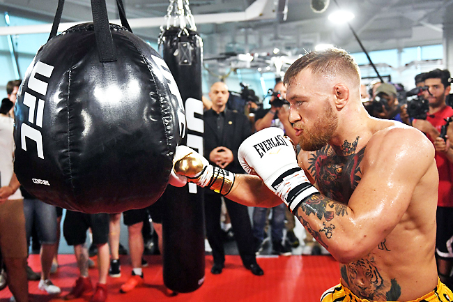 UFC lightweight champion Conor McGregor hits an uppercut bag during a media workout at the UFC Performance Institute in Las Vegas. - AFP