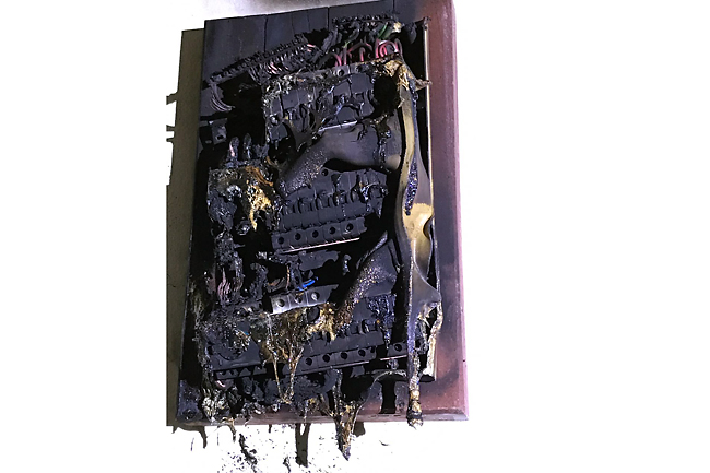 The charred electrical distribution board. - FIRE AND RESCUE DEPARTMENT