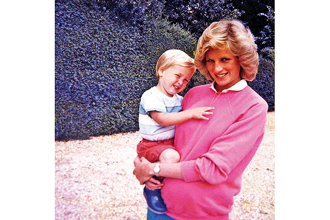 Photo made available by the Kensington Palace from the personal photo album of the late Diana, Princess of Wales, shows the princess holding Prince William while pregnant with Prince Harry, and features in the new ITV documentary 'Diana, Our Mother: Her Life and Legacy'