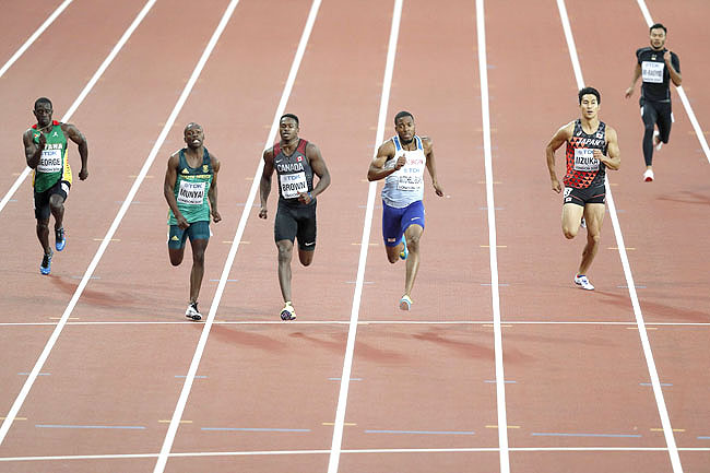 From Left: Guyana's Winston George, South Africa's Clarence Munyai, Canada's Aaron Brown, Britain's Nethaneel Mitchell-Blake, Japan's Shota Iizuka and Brunei's Muhd Noor Firdaus Ar-Rasyid compete in the heats of the men's 200m athletics event at the 2017 IAAF World Championships. - AFP