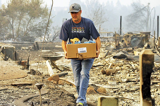 California A Man Retrieves Belongings From Safe Where His House Once Stood In The Fountaingrove Area Of Santa Rosa PHOTOS AP Fire