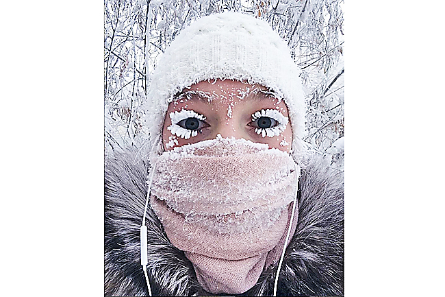 Even eyelashes freeze at this Russian village