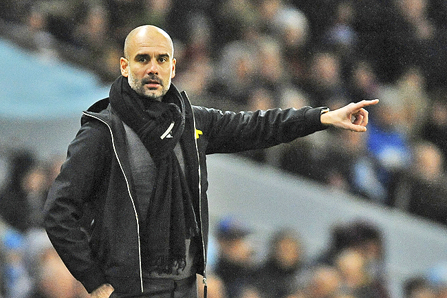 Guardiola calls on bosses to give referees a break