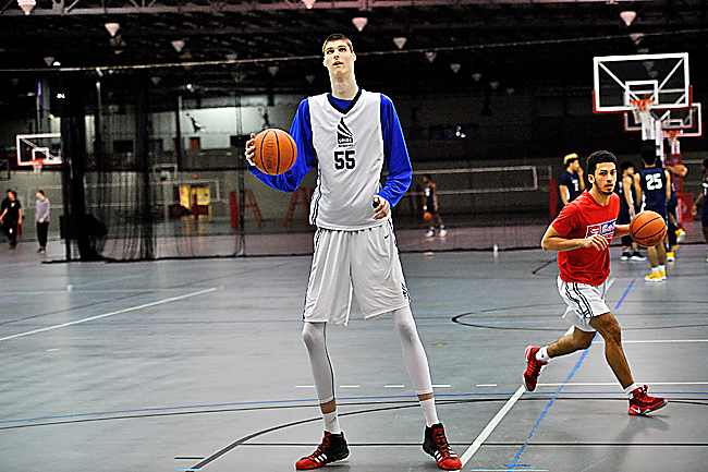 332759c83aa 7-foot tall basketball player a star attraction despite rarely ...