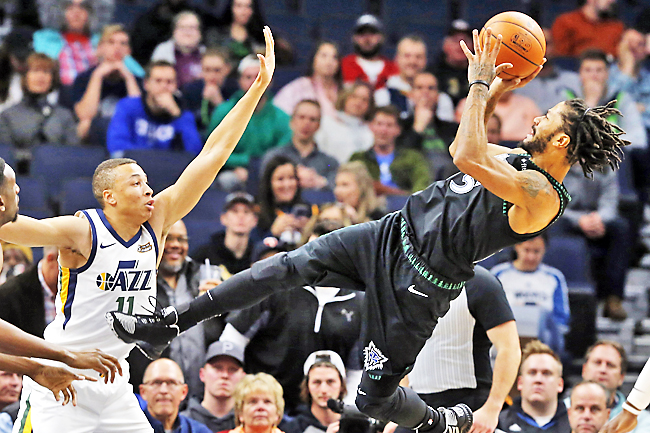 d82cfb99c49f Minnesota Timberwolves  Derrick Rose (R) takes a fall-back shot as Utah  Jazz s Dante Exum defends. – AP. ""