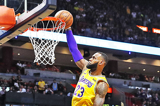 b2158d9cd Los Angeles Lakers forward LeBron James scores during the first quarter of  an NBA basketball game against the Miami Heat in Miami