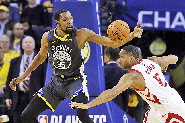 f350965e8277 Golden State Warriors  Kevin Durant (L) is defended by Houston Rockets   Eric Gordon.